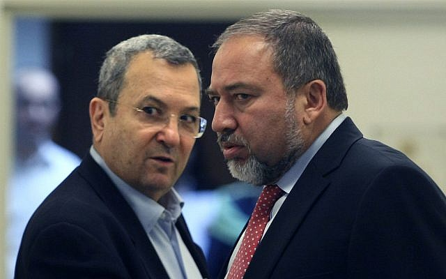 Then-defense minister Ehud Barak, left, and then-foreign minister Avigdor Liberman, right, arrive at a weekly cabinet meeting at the Prime Minister's office in Jerusalem, November 13,  2011. (Kobi Gideon/Flash90)