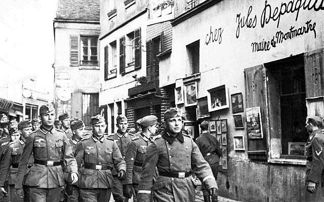 Nazi soldiers march through Paris, France, October 24, 1940. (AP)