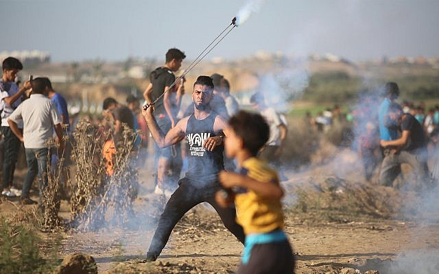 Palestinian protesters clash with Israeli forces at a demonstration along the Gaza border near Gaza City, September 6, 2019. (Hassan Jedi/Flash90)