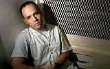 Death row inmate Randy Halprin sits in a visitation cell at the Polunsky Unit in Livingston, Texas, December 3, 2003. (AP Photo/Brett Coomer)