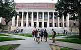 Students walk near the Widener Library in Harvard Yard at Harvard University in Cambridge, Massachusetts, August 13, 2019. (AP Photo/Charles Krupa, File)