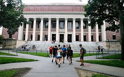 Students walk near the Widener Library in Harvard Yard at Harvard University in Cambridge, Massachusetts, August 13, 2019. (AP Photo/Charles Krupa, File)