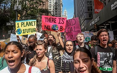 Illustrative: Climate change activists participate in an environmental demonstration as part of a global youth-led day of action, September 20, 2019, in New York. (AP Photo/Bebeto Matthews)