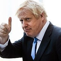 Britain's Prime Minister Boris Johnson gestures as he departs from Hudson Yards, in New York, September 24, 2019. (AP Photo/Matt Rourke)