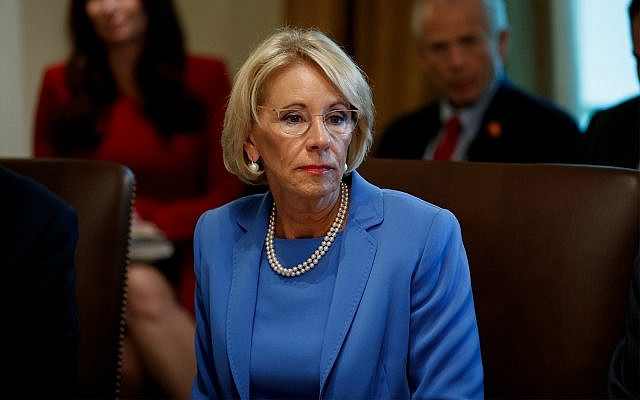 Education Secretary Betsy DeVos listens during a Cabinet meeting in the Cabinet Room of the White House in Washington, July 16, 2019. (AP Photo/Alex Brandon, File)