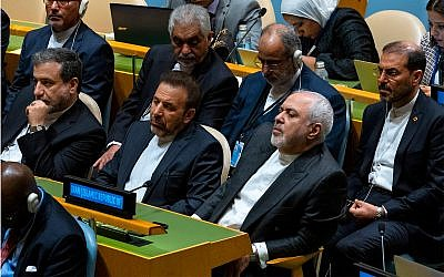 Iranian Foreign Minister Mohammad Javad Zarif, center far right, and others in the Iranian delegation listen to Iran's President Hassan Rouhani address the 74th session of the United Nations General Assembly, September 25, 2019. (AP Photo/Craig Ruttle)