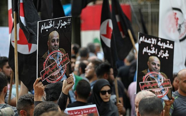Former detainees of the pro-Israel South Lebanon Army (SLA) militia hold posters depicting former SLA member Amer al-Fakhoury during a demonstration denouncing his return and entry outside the Justice Palace in the Lebanese capital Beirut on September 12, 2019. (NWAR AMRO/AFP)
