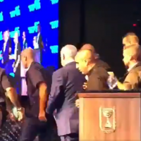 Prime Minister Benjamin Netanyahu taken off stage during a campaign event in Ashdod due to incoming rocket sirens, September 10, 2019. (Screenshot: Twitter)