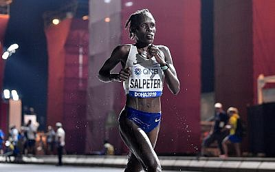Israeli runner Lonah Chemtai Salpeter competes in the women's marathon at the World Athletics Championships in Doha, Qatar, September 28, 2019. (AP Photo/Martin Meissner)
