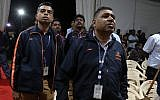 Indian Space Research Organization (ISRO) employees react as they listen to an announcement by organizations's chief Kailasavadivoo Sivan at its Telemetry, Tracking and Command Network facility in Bangalore, India, September 7, 2019. (AP Photo/Aijaz Rahi)