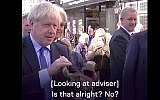 UK Prime Minister Boris Johnson attempts to sound a shofar in video published on September 13, 2019. (Screenshot/Channel  5 News)