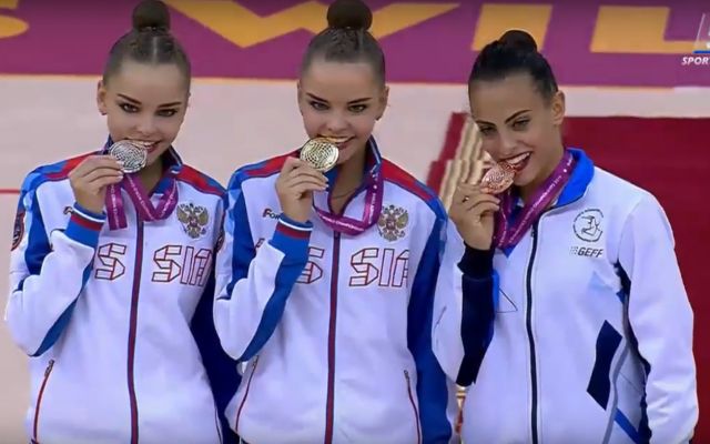 Israel's Linoy Ashram (R) with her all-around bronze medal at the rhythmic gymnastics world championships in Baku, Azerbaijan on September 20, 2019, alongside gold and silver medalists Dina (center) and Arina Averina of Russia. (Screenshot: YouTube)