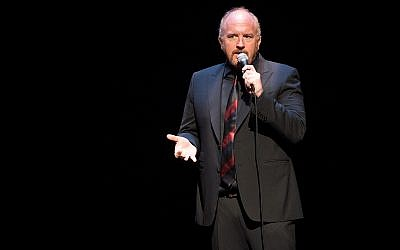 Comedian Louis C.K. performs at the David Lynch Foundation Benefit for Veterans with PTSD in New York City, April 30, 2016. (Scott Roth/Invision/AP)