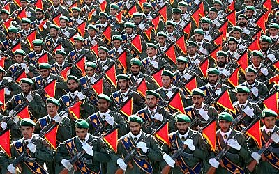 Iran's Revolutionary Guard troops march in a military parade marking the 36th anniversary of Iraq's 1980 invasion of Iran, in front of the shrine of late revolutionary founder Ayatollah Khomeini, just outside Tehran, Iran, September 21, 2016.  (AP Photo/Ebrahim Noroozi, File)