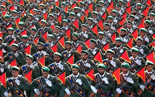 Iran's Revolutionary Guard troops march in a military parade marking the 36th anniversary of Iraq's 1980 invasion of Iran, in front of the shrine of late revolutionary founder Ayatollah Khomeini, just outside Tehran, Iran, September 21, 2016. (AP Photo/ Ebrahim Noroozi, File)