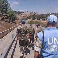 UN peacekeepers and IDF officers visit the site of a Hezbollah missile attack on IDF positions in northern Israel on September 4, 2019. (Israel Defense Forces)
