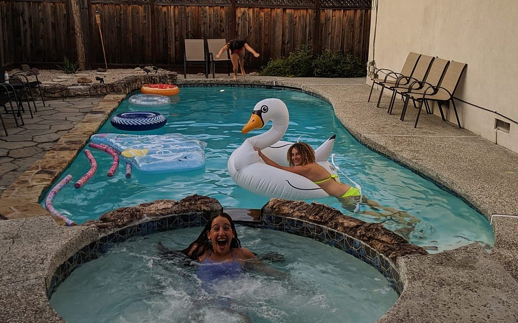 Swimming in a private pool in San Jose, California rented on the Swimply app on September 10, 2019. (Robert Ungar/Times of Israel)