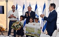 (From L-R) Jordan Valley Regional Council chairman David Elhayani, Prime Minister Benjamin Netanyahu and cabinet secretary Tzachi Braverman applaud after the government authorized the legalization of the Mevo'ot Yericho outpost at the weekly cabinet meeting at the Jordan Valley Regional Council, September 15, 2019 (Haim Tzach/GPO)