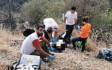 Medics treat a man at the Amud Stream nature reserve after his 11-year-old son directed them to the scene (Magen David Adom)