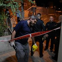 Police inspect the scene of the murder of Anan Luabana in the northern city of Nazareth on Sunday evening, September 23, 2019. (Israel Police Spokesperson)