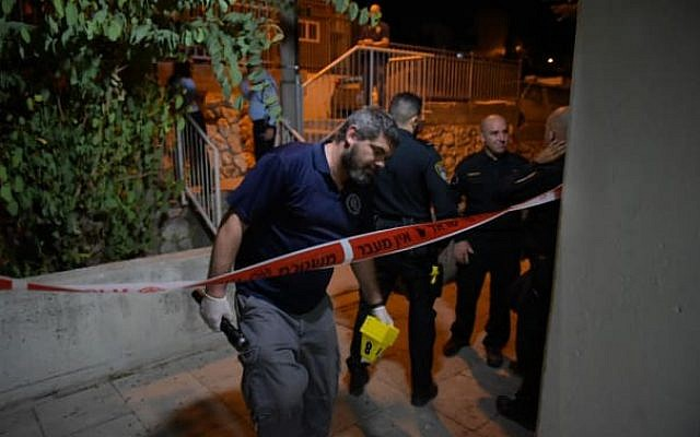 Illustrative: Police inspect the scene of a murder in the northern city of Nazareth on Sunday evening, September 23, 2019. (Israel Police Spokesperson)
