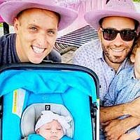 This undated photo provided by Immigration Equality shows Roee, left, and Adiel Kiviti, right, with their children newborn, Kessem and older brother Lev. The Maryland couple is suing to challenge the State Department's refusal to recognize the US citizenship of their infant daughter, who was born in Canada to a surrogate mother this year. (Courtesy of Adiel and Roee Kiviti/Immigration Equality via AP)