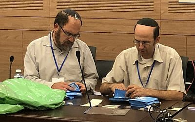 Lawyers at the Knesset in Jerusalem check votes cast during elections on September 17, in a final review prior to presentation of the results to President Reuven Rivlin, September 23, 2019. (Sue Surkes).