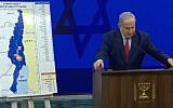 Prime Minister Benjamin Netanyahu delivering a campaign address next to a map of proposed areas of the West Bank for annexation on September 10, 2019. (screen capture: Facebook)