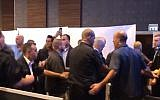 Prime Minister Benjamin Netanyahu, center, being moved away from a campaign event stage while surrounded by security as rockets are shot at Ashdod on September 10, 2019. (screen capture: Twitter)