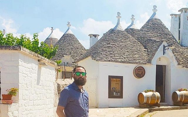 Rabbi Daniel Bortz in front of the white stone huts in Alberobello, Italy. (Courtesy)