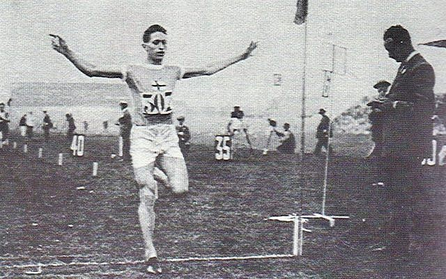Elias Katz crossing the finish line at the Helsinki Stadium, circa 1920s. (screenshot)