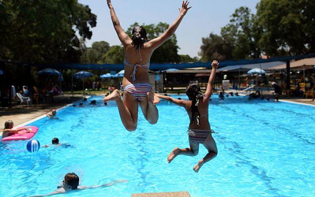 Young girls playing in the pool near K Kibbutz Beit Govrin near Jerusalem on October 10, 2011. (Nati Shohat/Flash90)