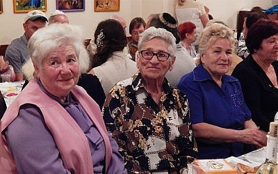 Elderly Jews attending the Rosh Hashanah dinner at Hesed Triaspol, Transnistria, in 2018. (Courtesy of JDC)