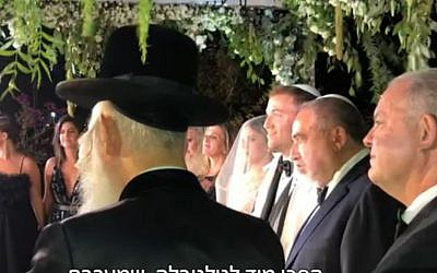 Avigdor Liberman (2nd R) at the wedding of his son Amos on September 26, 2019 (Screencapture/Channel 12)