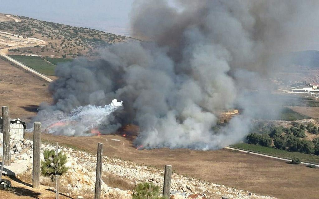 Smoke rises near the community of Avivim following an anti-tank missile attack from Lebanon on September 1, 2019. (Courtesy)