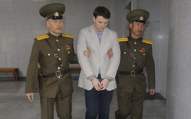 American student Otto Frederick Warmbier, center, arrives at a court for his trial in Pyongyang, capital of the Democratic People's Republic of Korea, on March 16, 2015. (Xinhua/ Lu Rui via Getty Images)