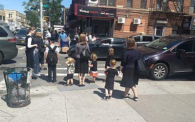 Women and children wait at a crosswalk in the Orthodox neighborhood of Borough Park, Brooklyn, Sept. 3, 2019. (Ben Sales/JTA)