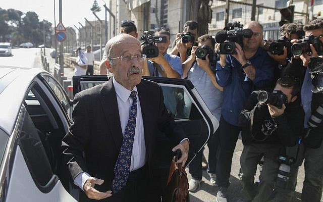 Prime Minister Benjamin Netanyahu's lawyer Ram Caspi arrives at the Justice Ministry headquarters in Jerusalem on October 2, 2019, for the start of Netanyahu's pre-indictment hearing. (Menahem Kahana/AFP)
