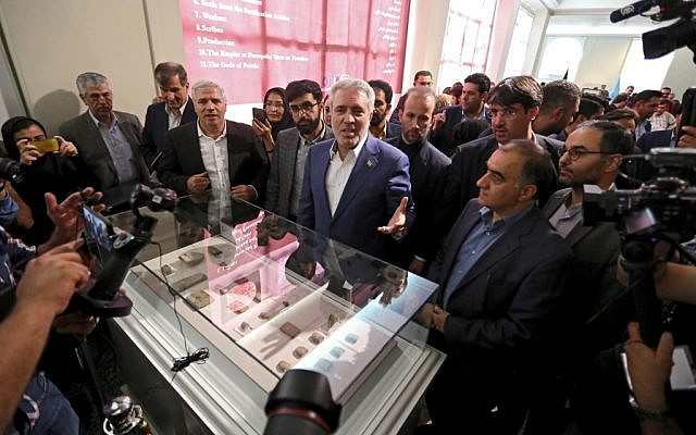 Ali Asghar Mounesan (C), Iran's Minister of Cultural Heritage, Tourism, and Handicrafts, speaks to journalists while viewing Achaemenid-era clay tablets on display at Iran's National Museum in the capital Tehran on October 2, 2019 (ATTA KENARE / AFP)
