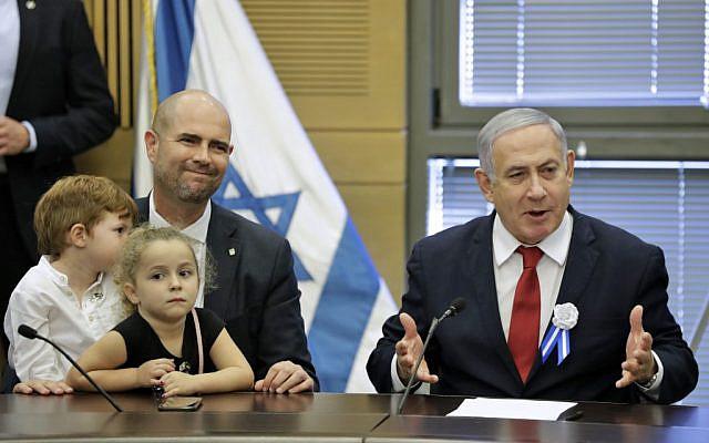 Prime Minister Benjamin Netanyahu (R) speaks during a Likud faction meeting at the Knesset in Jerusalem on October 3, 2019. (Emmanuel Dunand/AFP)