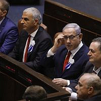 Prime Minister Benjamin Netanyahu (C) fixes his eyeglasses during the swearing-in ceremony at the Knesset in Jerusalem on October 3, 2019 (Menahem KAHANA / AFP)