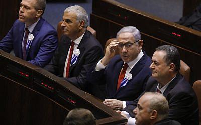 Prime Minister Benjamin Netanyahu (C) fixes his eyeglasses during the swearing-in ceremony at the Knesset in Jerusalem on October 3, 2019 (Menahem KAHANA / AFP)