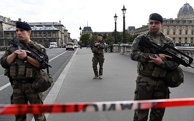 French soldiers stand guard near the police headquarters in Paris on October 3, 2019, after four officers were killed in a stabbing attack. (Bertrand Guay/AFP)
