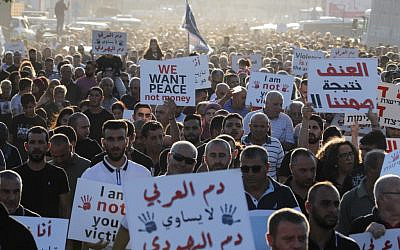 Israeli Arabs protest against violence, organized crime and recent killings in their communities, in the Arab town of Majd al-Krum in northern Israel on October 3, 2019. (Ahmad GHARABLI / AFP)