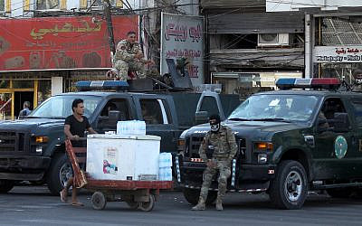 Iraqi security forces keep watch at Tahrir Square in central Baghdad on October 5, 2019, after a curfew was lifted following a day of violent protests. (Ahmad Al-Rubaye/AFP)