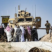 Syrian Kurds take part in a demonstration against Turkish threats at a US-led international coalition base on the outskirts of Ras al-Ain town in Syria's Hasakeh province near the Turkish border on October 6, 2019.  (Delil SOULEIMAN / AFP)