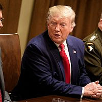 US Secretary of Defense Mark Esper (L) and Chairman of the Joint Chiefs of Staff Army General Mark A. Milley (R) listen while US President Donald Trump speaks before a meeting with senior military leaders in the Cabinet Room of the White House in Washington DC on October 7, 2019. (Brendan Smialowski / AFP)