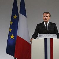 French President Emmanuel Macron speaks during a ceremony for the four victims of last week's knife attack in the courtyard of the Paris police headquarters, on October 8, 2019 in Paris. - France's presidency says the four victims of last week's knife attack at the Paris police headquarters will be posthumously given France's highest award, the Legion of Honor. (AP Photo/Francois Mori, Pool) (Photo by Francois Mori / POOL / AFP)