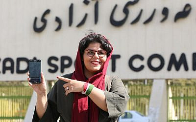 Iranian sports journalist Raha Pourbakhsh shows purchased electronic tickets for the Iran - Cambodia World Cup 2022 soccer qualifier match during an interview with AFP in front of Azadi stadium in the capital Tehran on October 8, 2019. (ATTA KENARE / AFP)