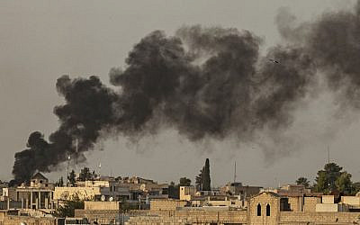 Smoke billows following Turkish bombardment on Syria's northeastern town of Ras al-Ain in the Hasakeh province along the Turkish border on October 9, 2019 (Delil SOULEIMAN / AFP)
